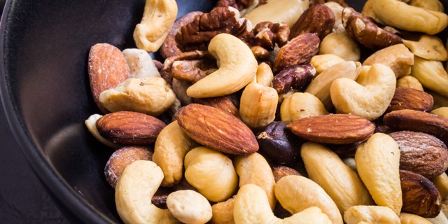 Mixed nuts in dishes; Shutterstock ID 142361836; PO: aol; Job: production; Client: drone