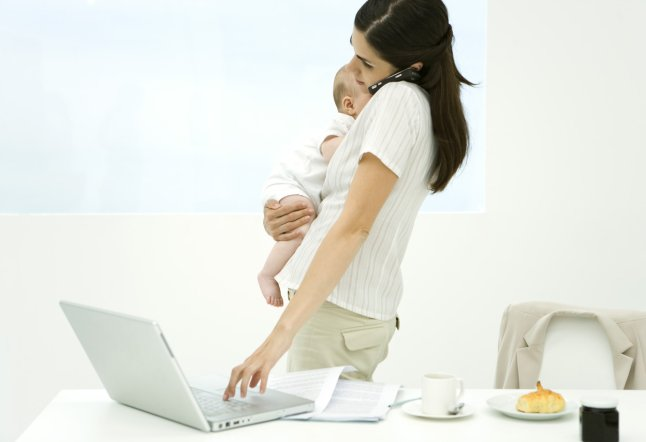 Professional Woman Standing Beside Breakfast Table,holding Baby,cell Phone and Laptop Computer