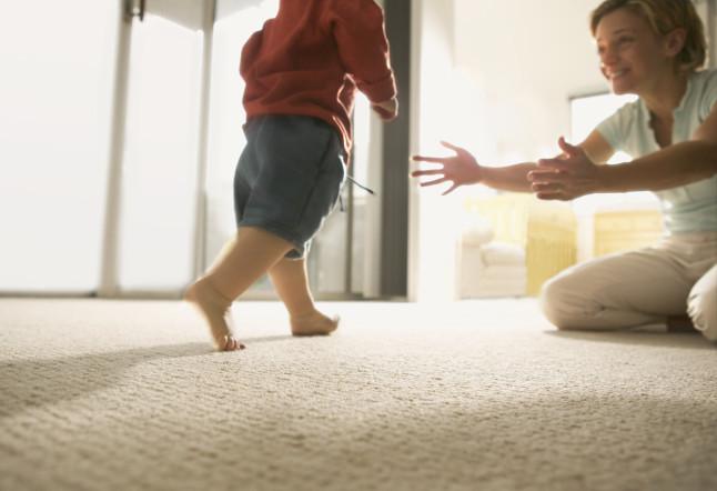 Toddler Walking Towards Mother