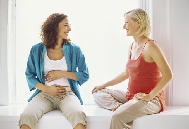 Two Pregnant Women Talking