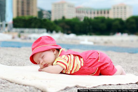 o-BABY-SLEEPING-BEACH-570
