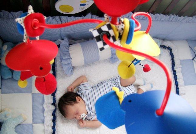 Baby Sleeping under Mobile