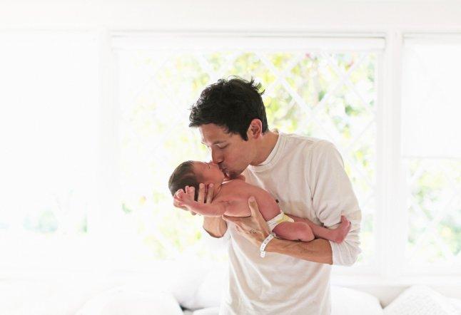 New father holding newborn son