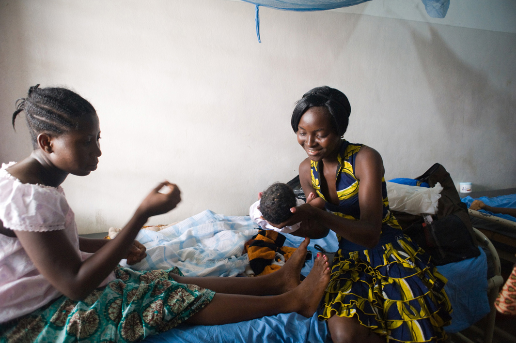 A visitor holds Habibat Adeboye's baby shortly after delivery at