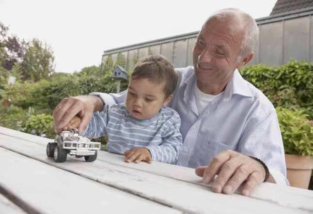 Man and Grandson Playing with Toy Car