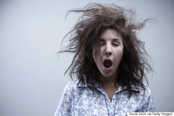 Young woman yawning, close up